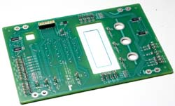 Backside of a printed circuit board switch on which many components are mounted